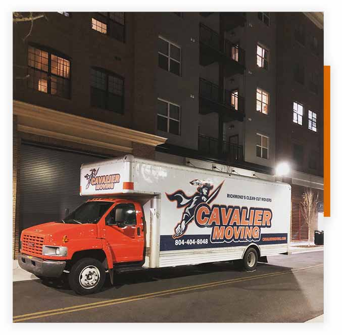 This image shows a Cavalier Moving truck parked outside an office for a commercial move.