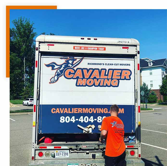 This image shows a Cavalier Moving crew memeber loading a moving truck.