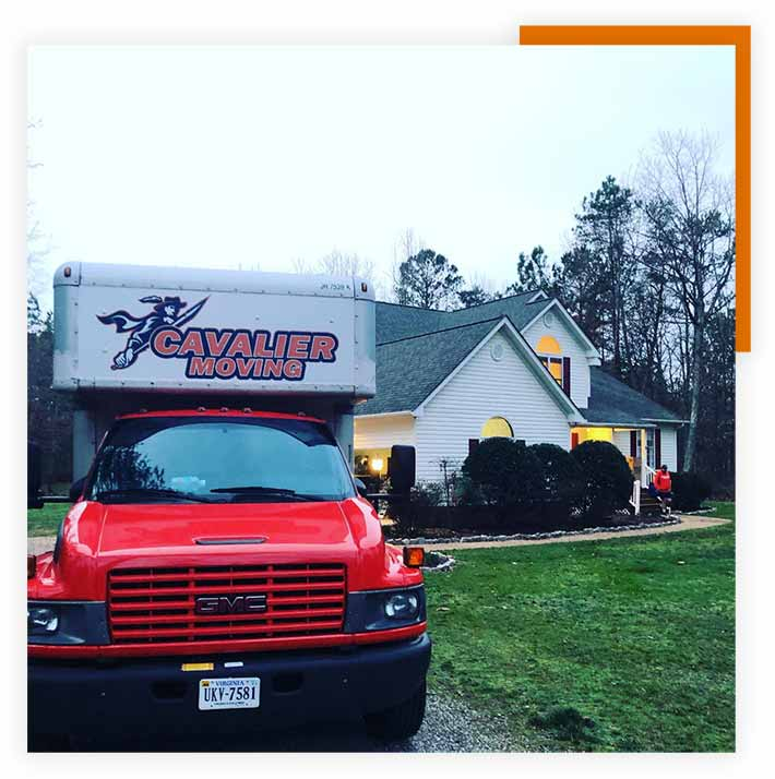 Pictured: a red Cavalier Moving truck parked at a house for a local move.