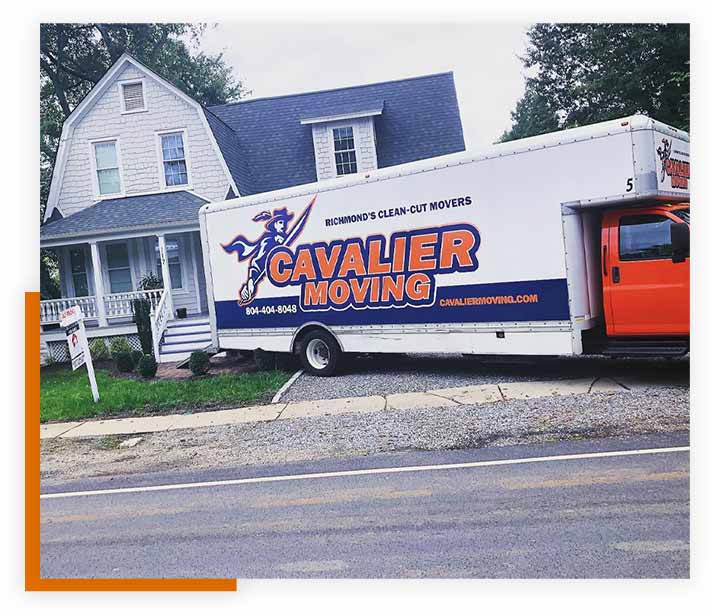 Pictured: A Cavalier Moving truck parked at a house for a long-distance move.