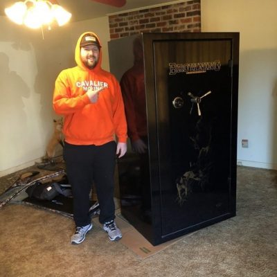 This image shows a Cavalier Moving crew member getting ready to move a large safe.